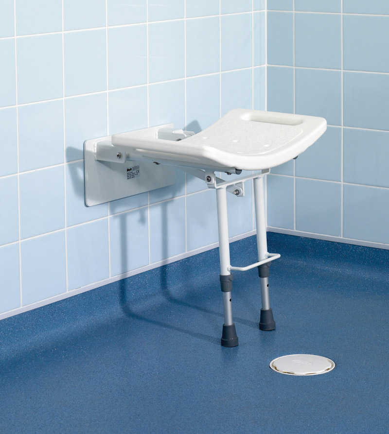 Wall mounted fold down hinged shower seat with adjustable support.